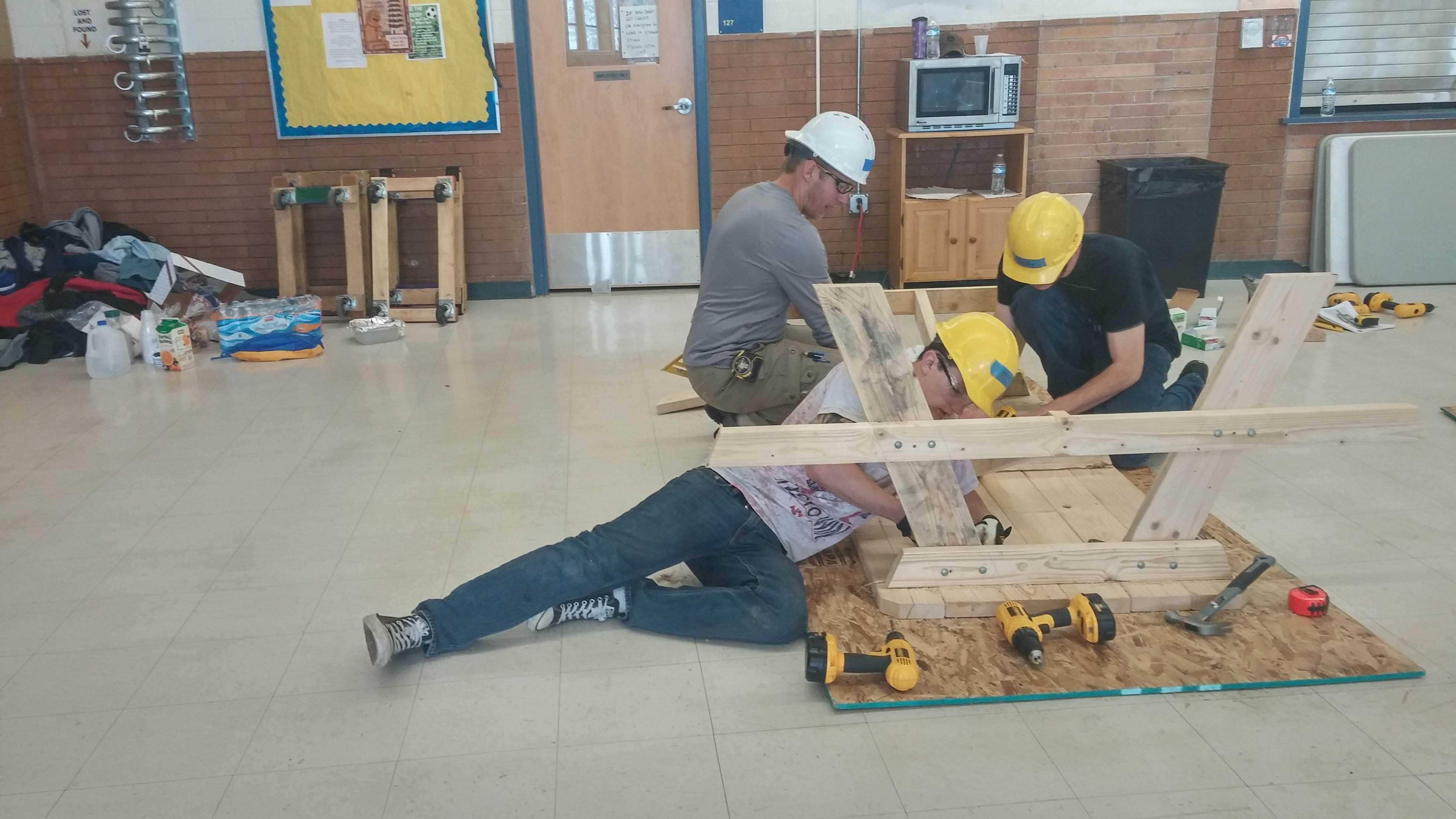 Students working on picnic tables last spring for Wheat Ridge's construction class. By Rachel Vigil File Photo