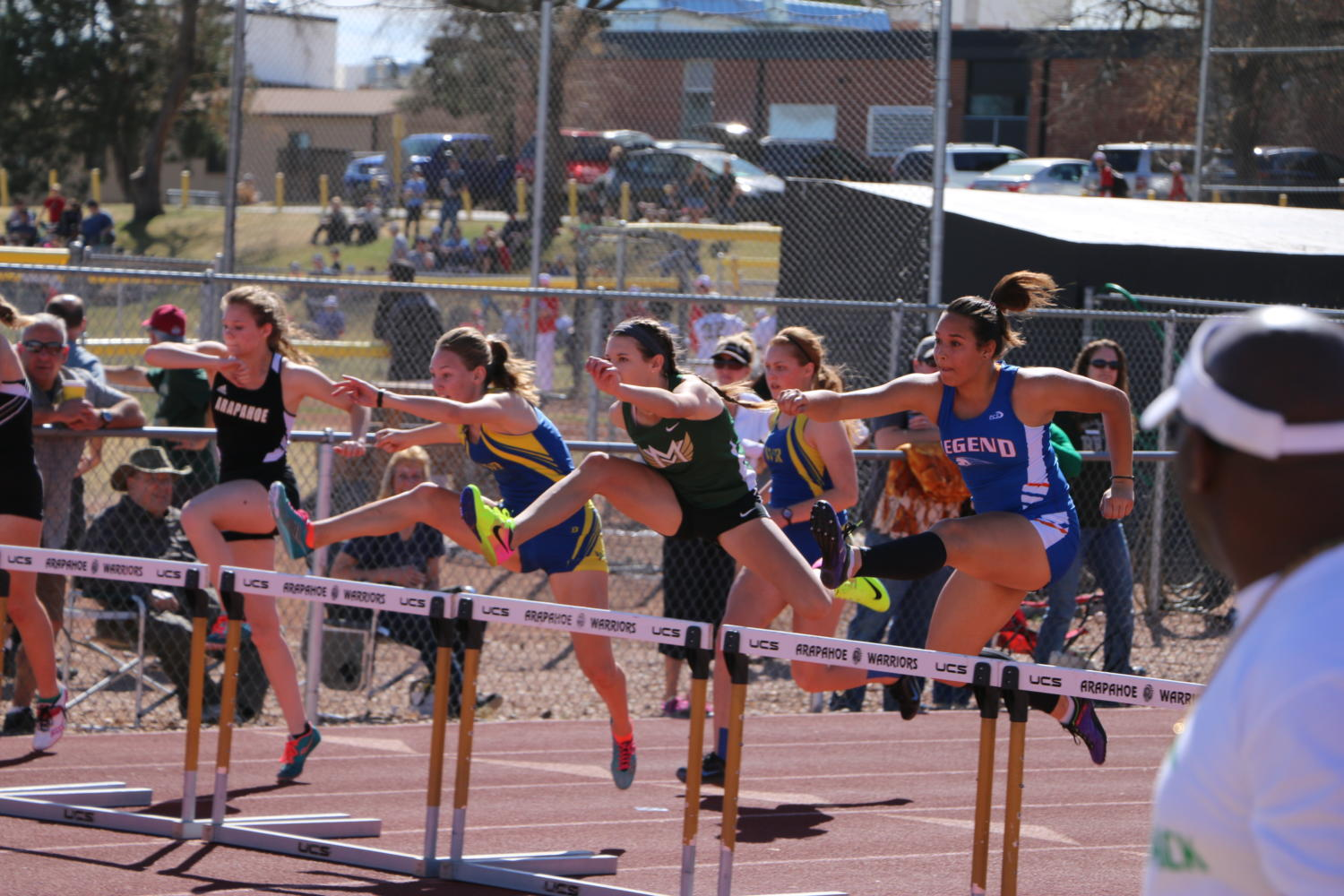 Lindsey+Roberts+running+the+300+meter+hurdles+at+a+track+meet.+courtesy+of+Scott+Chamberlin