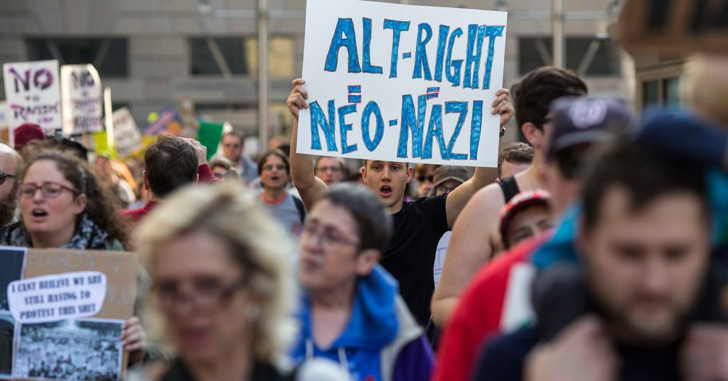 Protesters marching in Washington, outside an Alt-Right conference. Courtesy of The New York Times