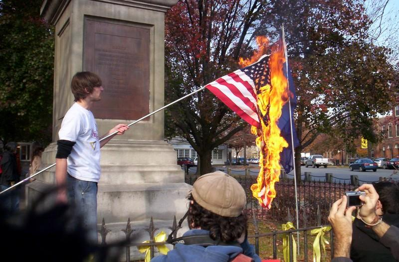 A man exercising his First Amendment rights by burning the flag. Courtesy of thefreepatriot.com