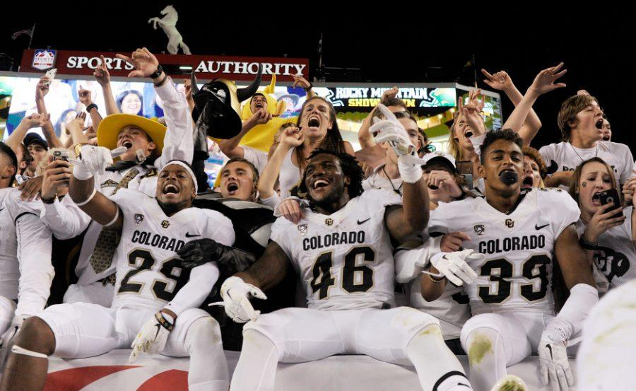 DENVER, CO - SEPTEMBER 19: Colorado Buffaloes players celebrates with fans after the second half of the Buffs' 27-24 overtime Rocky Mountain Showdown win. The Colorado State Rams played the University of Colorado Buffs on Saturday, September 19, 2015. (Photo by AAron Ontiveroz/The Denver Post)