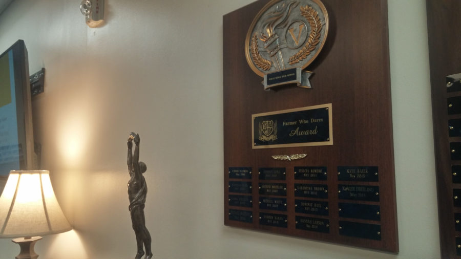 The+plaque+in+the+main+office+that+lists+past+recipients+of+the+Farmer+Who+Dares+Award+By+Rachel+Vigil