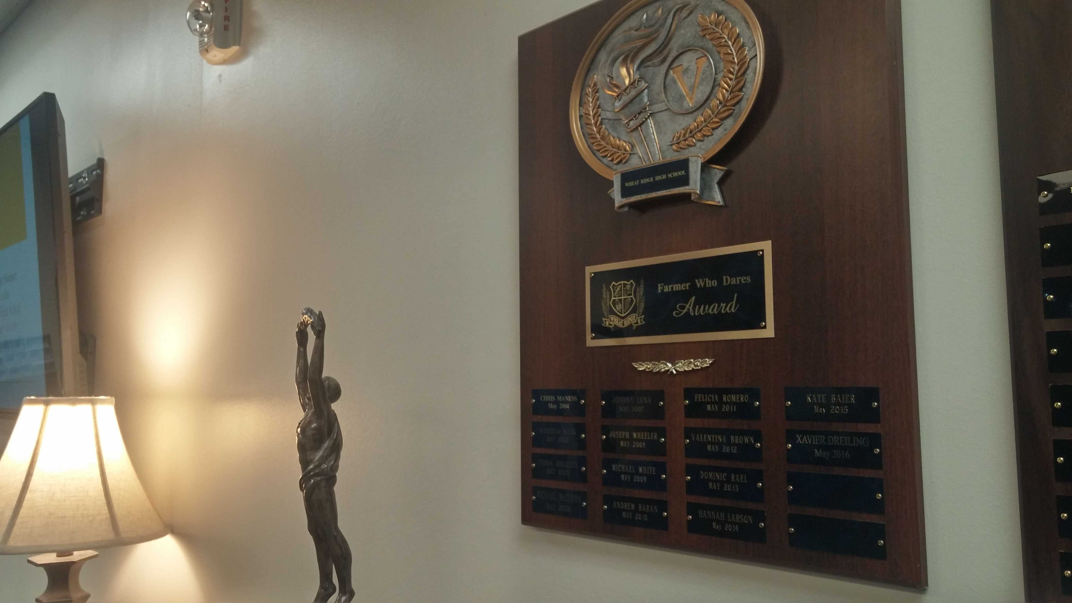 The plaque in the main office that lists past recipients of the Farmer Who Dares Award By Rachel Vigil