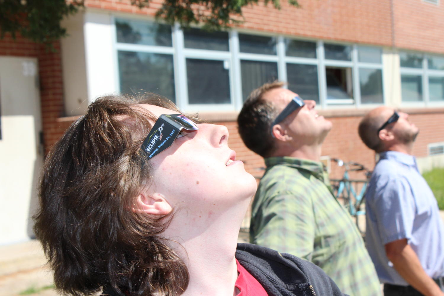 Student+Patrick+Brogan%2C+physics+teacher+Ron+Livingston%2C+and+math+teacher+Adam+Goudge+marvel+at+the+eclipse.
