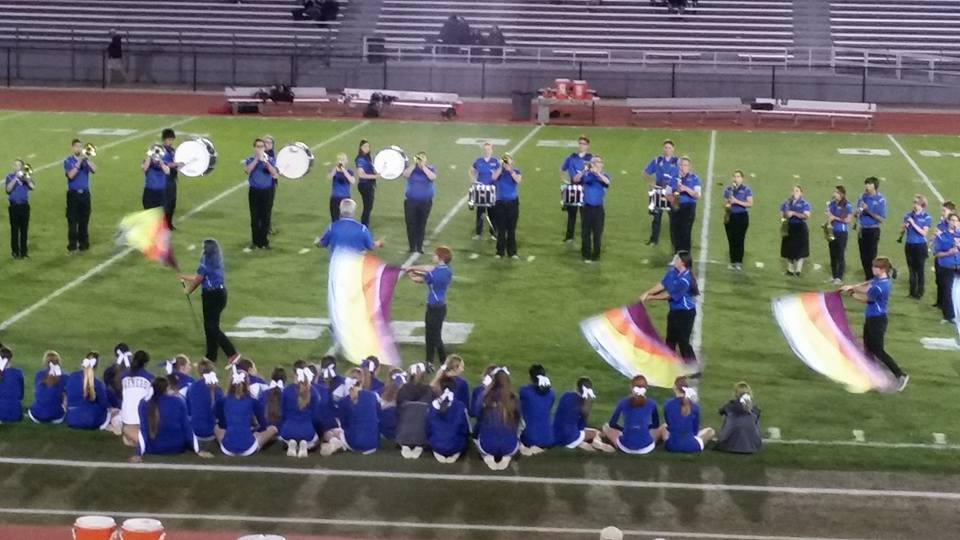 The Farmer Pride Band performing during half time at a football game. Courtesy of wrhsonline.org
