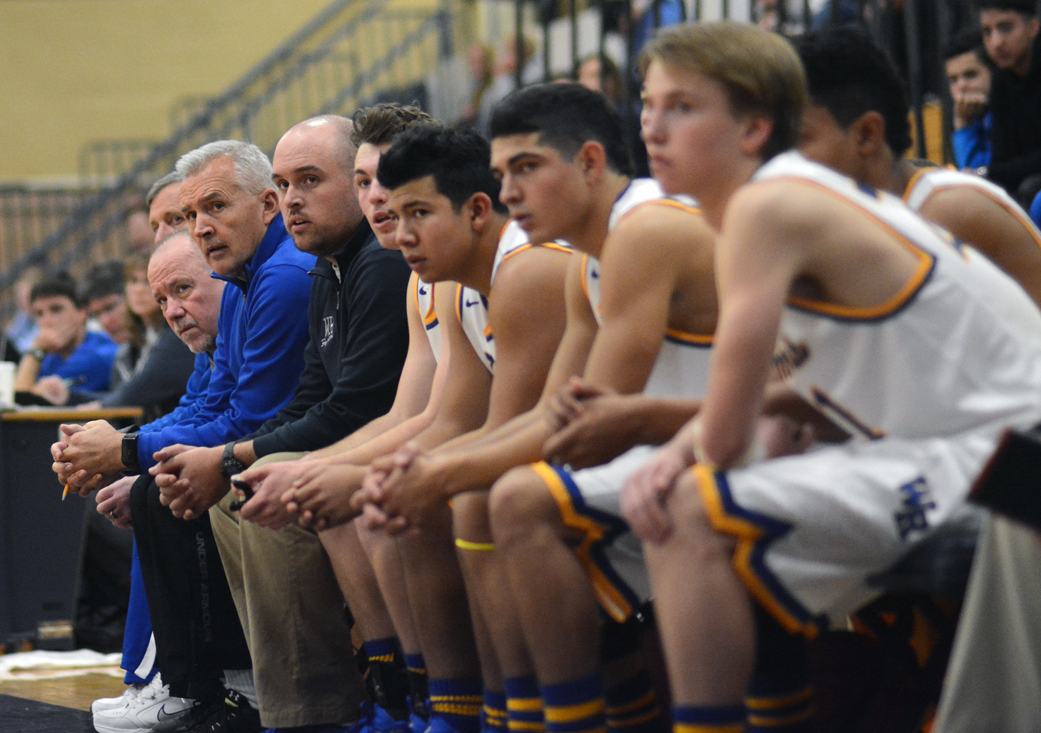 Coach Coach Dowd and boys' basketball team during a game.