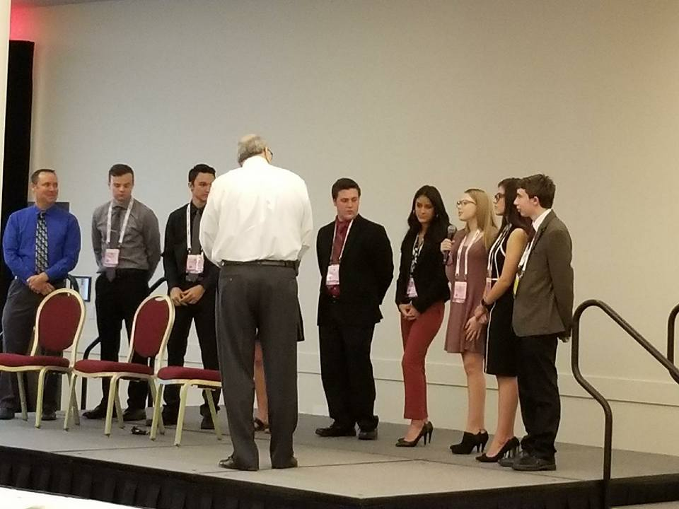 Students from Wheat Ridge High School's STEM department presenting at the AAPEX conference in Las Vegas.