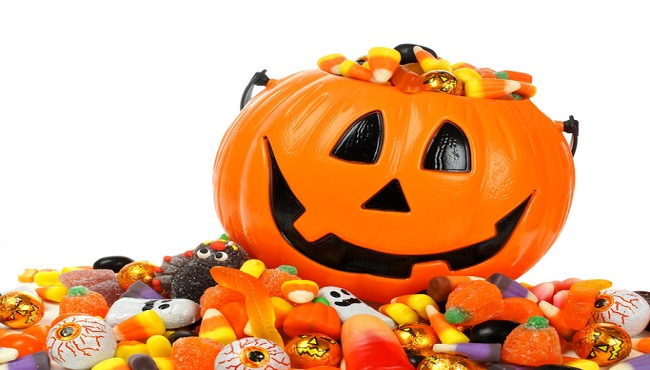 Jack-o-Lantern overflowing with Halloween candy