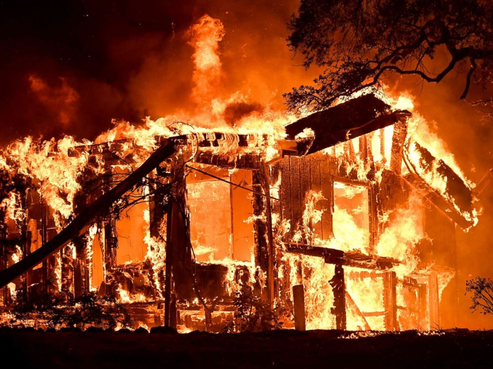 Flames ravage a home in the Napa wine region in California, Oct. 9, 2017.