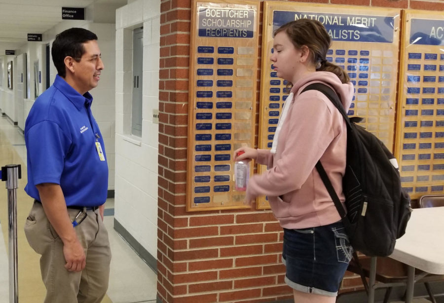 Martinez chatting with sophomore Sadie Estrada during lunch.