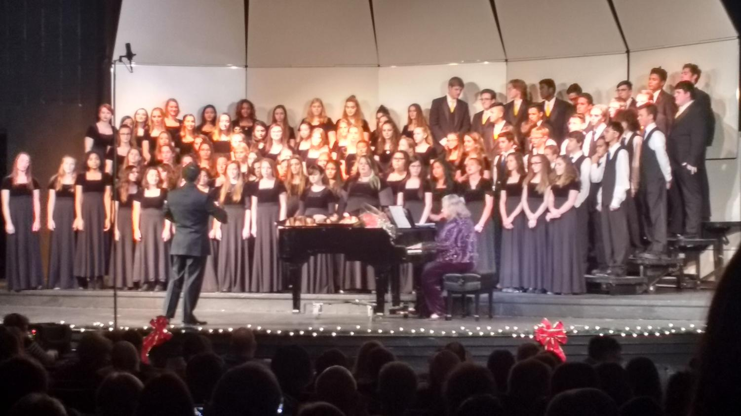 All choirs combined performing a final piece together.