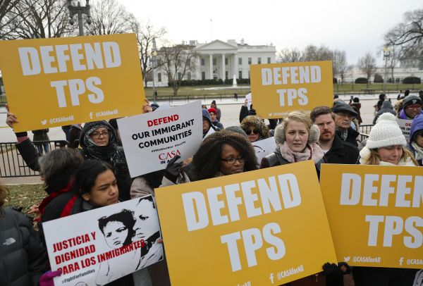 El Salvadorans protesting the removal of TPS.