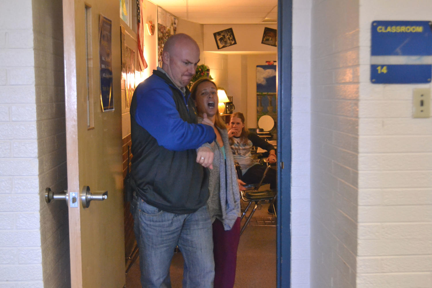 Murphy being dragged out of her classroom by Patrick Rock.