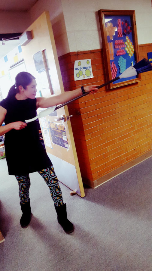 Kendra+Gothard+wields+her+broom.
