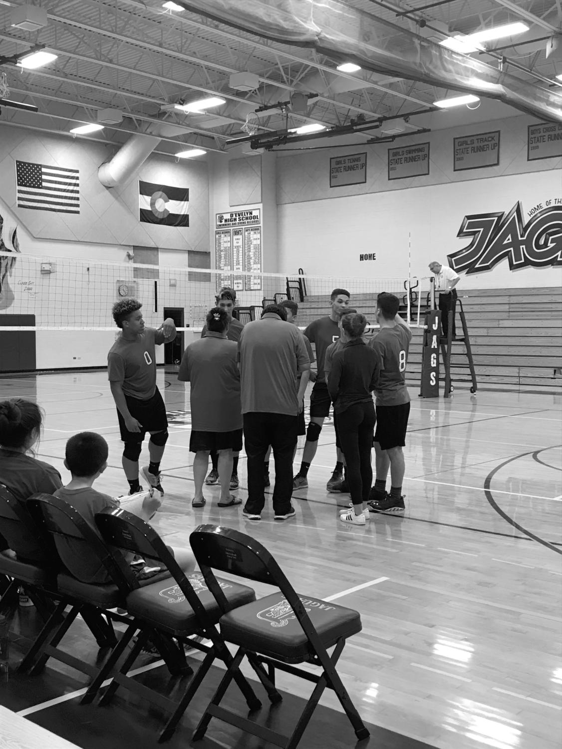 The volleyball team discusses  the game on April 26.