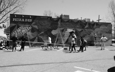Students working on Mural