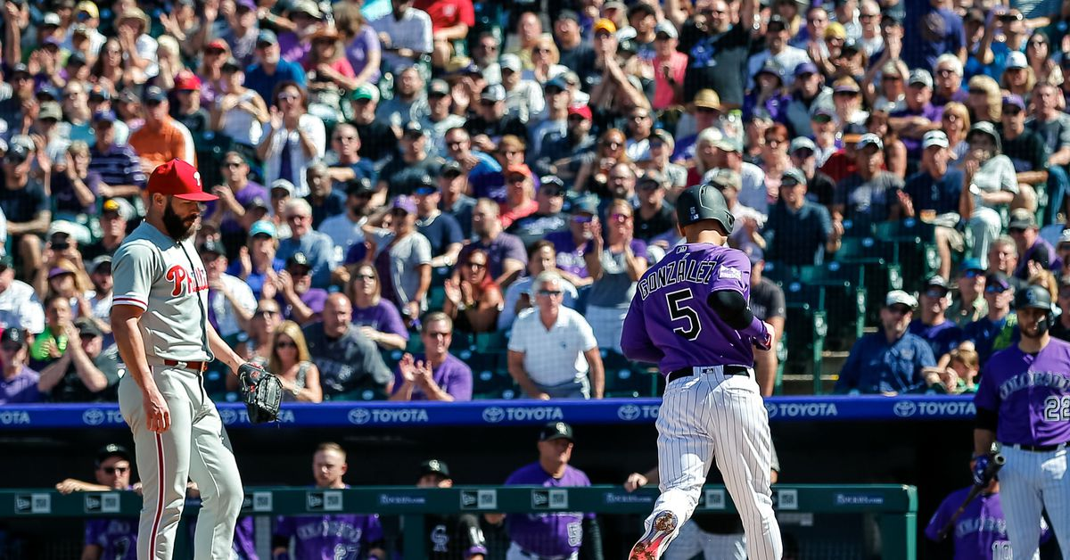 Rockies outfielder Carlos Gonzalez scores his only run against the Phillies during yesterday's game