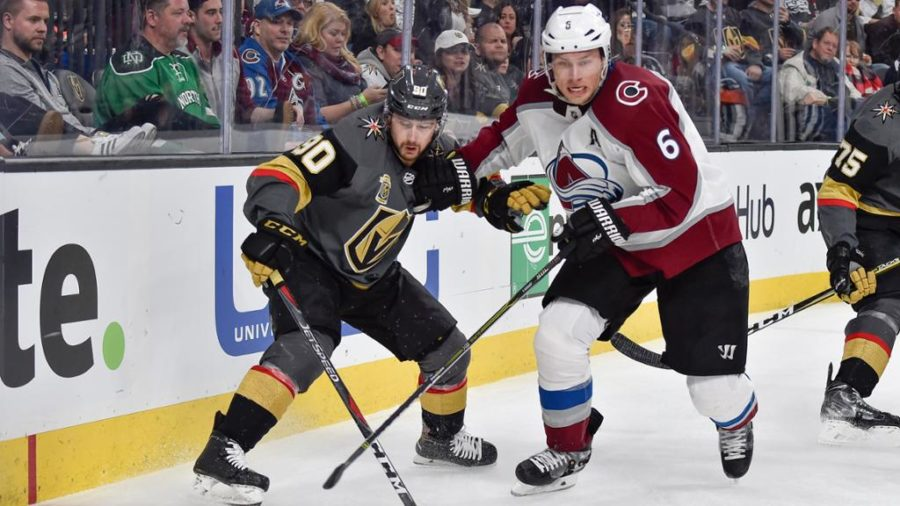 Avalanche defenseman Erik Johnson battles Vegas Golden Knights forward Tomas Tatar for puck possession