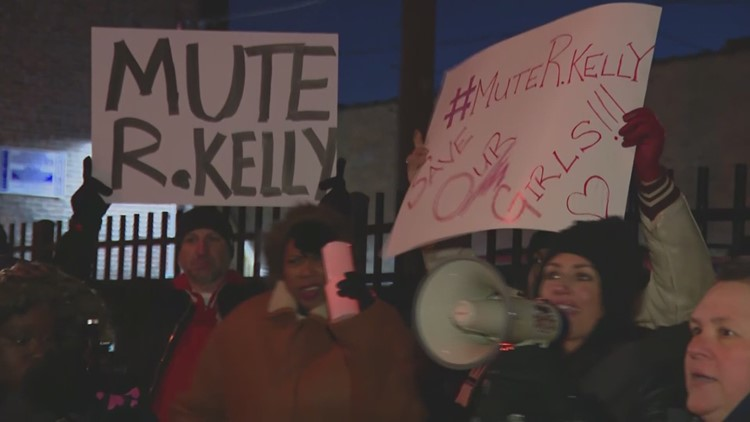 Protesters+holding+up+%22Mute+R+Kelly%22+posters.++