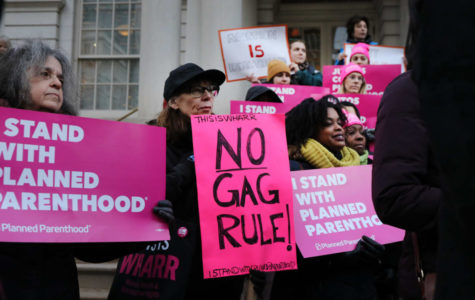 People protest on recent news of Planned Parent hood and Title X.