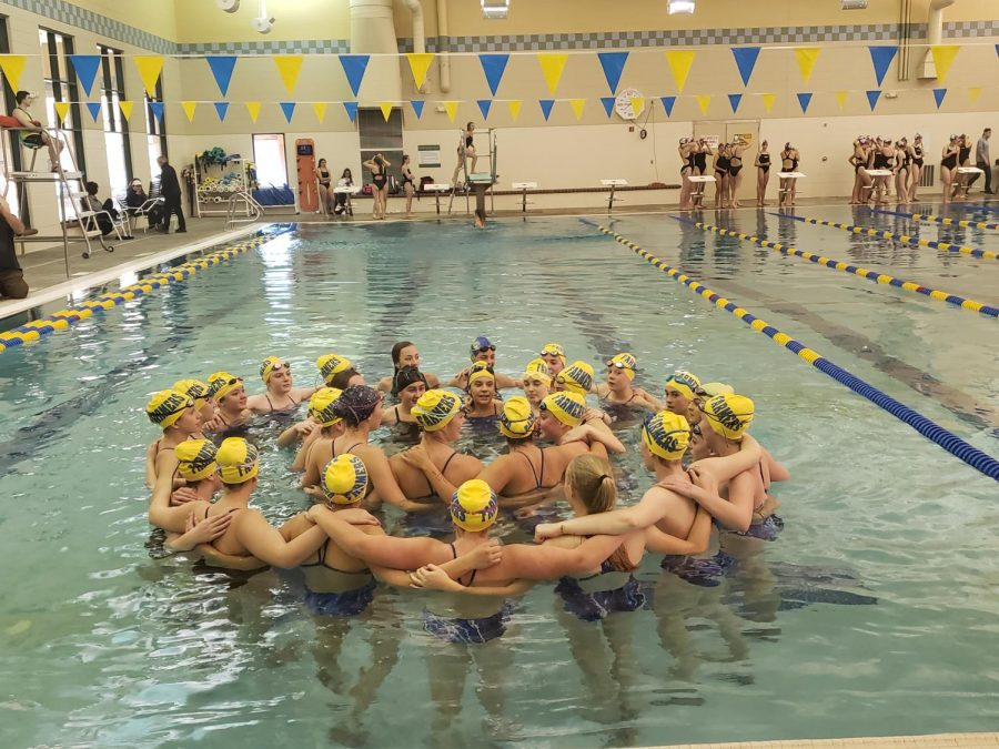 Wheat+Ridge+Girls+Swim+and+Dive+team+circle+up+before+starting+their+meet.