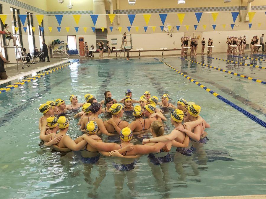 Wheat Ridge Girls Swim and Dive team circle up before starting their meet.