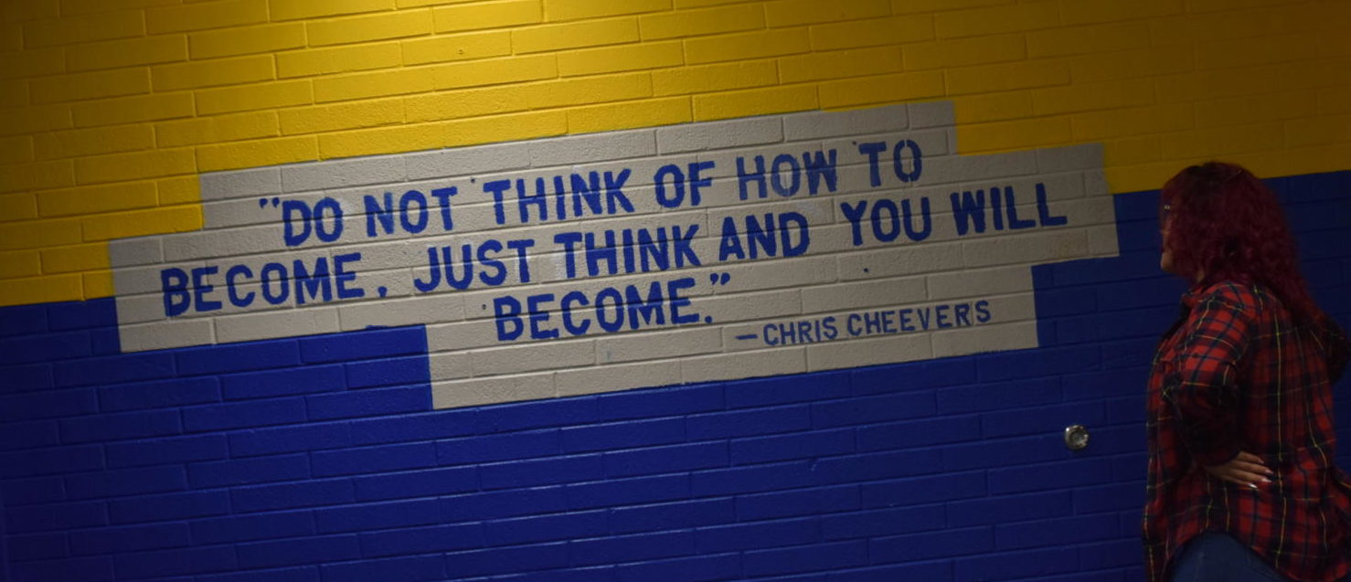 Leyla Gomez Staring at the Chris Cheevers quote featured in the Wheat Ridge High School annex.