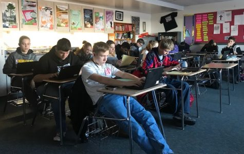 Sophomores in Kay Landon's English class prepare for next week's finals.