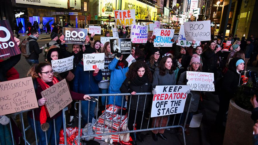 Here%2C+protesters+are+seen+outside+the+opening+of+the+new+production.+