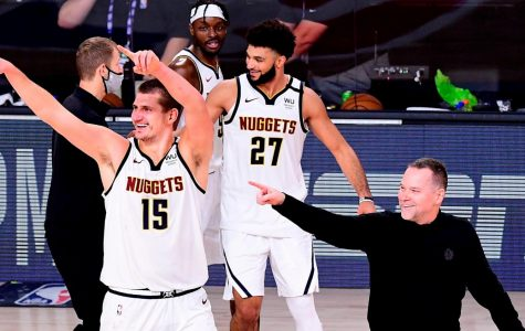 Nuggets, Jamal Murray (27), Nikola Jokic (15) and their head coach Mike Malone celebrate after game seven victory.