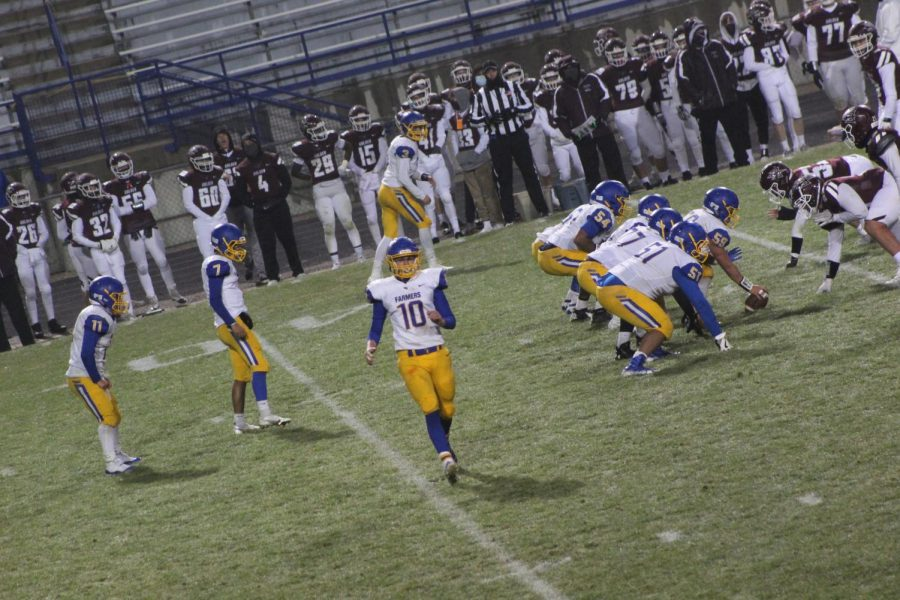 Wheat Ridge Farmers offensive line, getting ready to snap the ball against Golden
