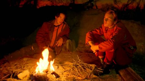 "Screenshot of the pivotal ""campfire scene"" in My Own Private Idaho, featuring Keanu Reeves and River Phoenix."