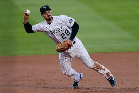 Nolan Arenado makes a quick catch and throw.