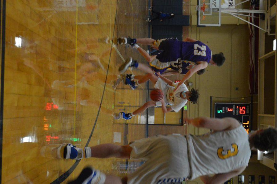 Senior Logan Ewers taking it up court.